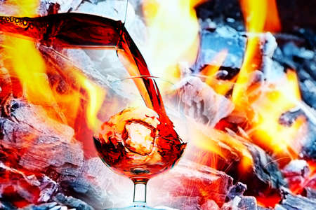 abstract image of a glass of wine and an open fire Stock Photo