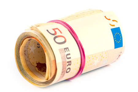 a pack of euro banknotes rolled into a tube and tied with a rubber band Stock Photo