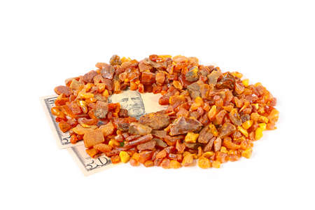 stack of dollar bill: precious mineral amber and some dollars banknotes as payment