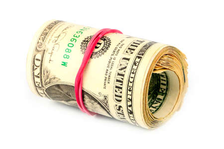 stack of dollar bill: rolled and related paper money dollars as part of the economic global payment system