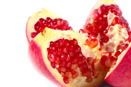 wholesome: pieces of fresh ripe tropical fruit pomegranate as an element of wholesome food
