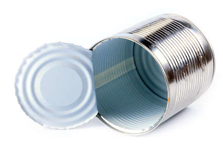 can opener: empty galvanized metal tin open with the help of a can opener Stock Photo