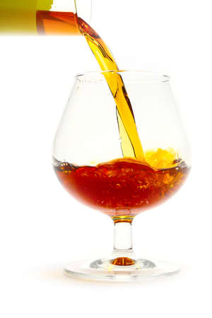strong drink is poured and creates beautiful patterns in the glass for drinking
