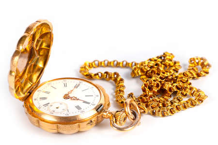 Pocket antique clock in the case of gold and metal chain for attaching to clothing Standard-Bild