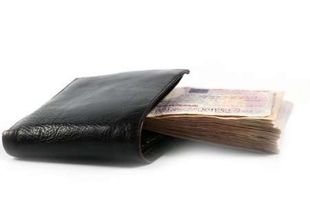 black wallet from genuine leather and a lot of British pounds as a symbol of abundance and success of the individual