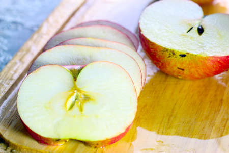 Slices of ripe beautiful fresh apple on a wooden board for cooking food