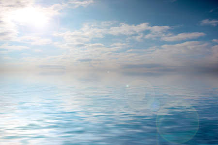 The surface of a calm sea with a small ripple under a sunny cloudy sky Stock Photo