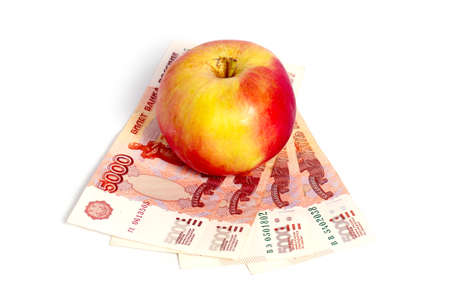 Fresh ripe red apple and Russian national paper bills