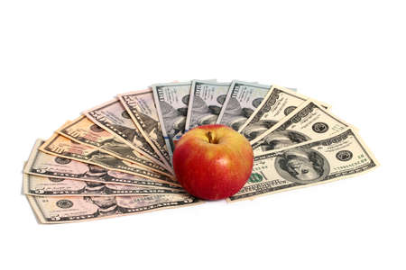 stack of dollar bill: A ripe fresh red apple lies on a pile of American dollars