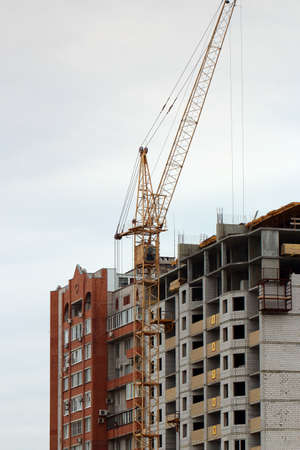 storey: High industrial crane on the construction of a multi-storey residential building