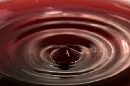 Patterns on the surface of the juice upon impact of a drop of liquid