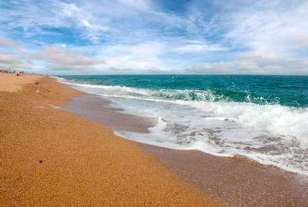 Beautiful sandy beach and blue sunny sky over the Mediterranean coast