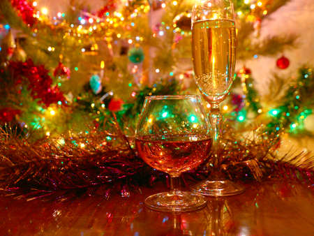 A glass of wine and strong alcohol on the background of a festive New Years decoration