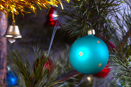 festively: Festively decorated New Year tree with lighting and glass toys Stock Photo
