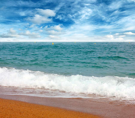 beautiful location: Beautiful sandy beach of the Mediterranean Sea and sunny sky with clouds