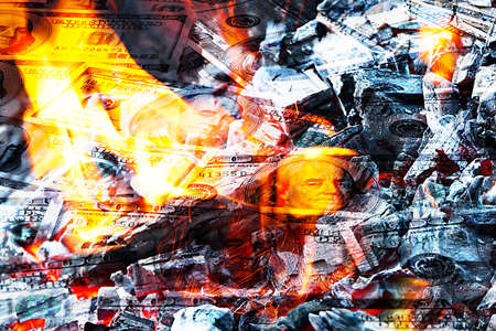 Paper money American dollar bills in bright fire as an illustration of the financial crisis