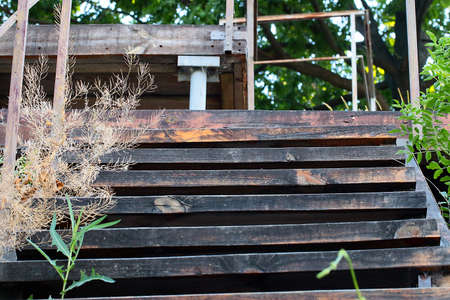 The texture and structure of the wooden steps of the ladder on the metal frame