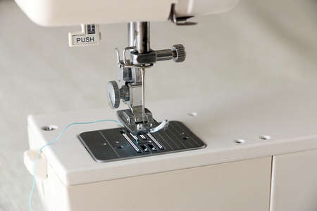 sewing machines: The needle and clamping feeder mechanism of a modern sewing machine Stock Photo