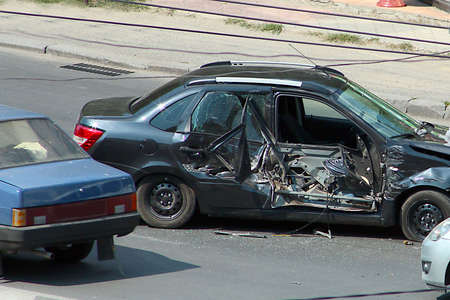 A broken car after a violent accident on the city road