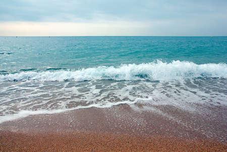 Beautiful sandy beach of the Mediterranean sea Catalunya Spain