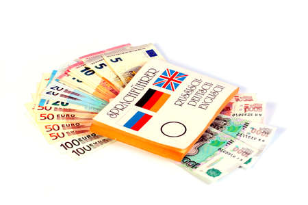 book dictionary translator and paper notes euro and russian rubles