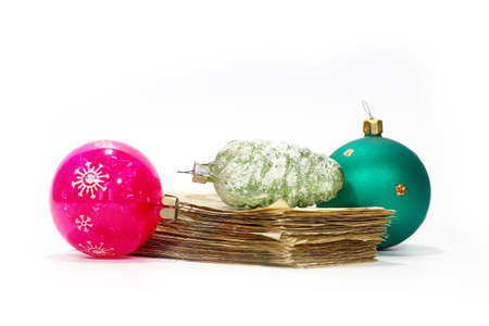 a bundle of paper money bills and beautiful glass Christmas decorations