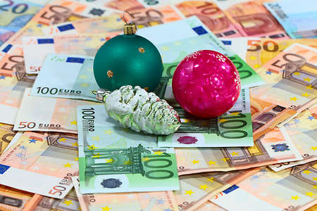 Christmas ornament on paper euro banknotes