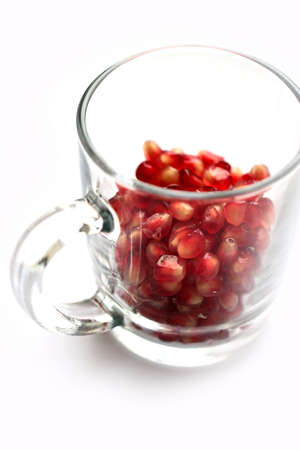 glass cup with lovely fresh grains of ripe pomegranate