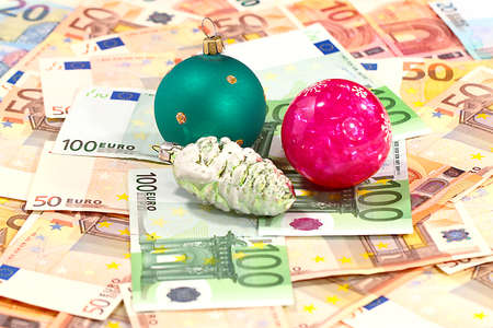 a pile of paper euros and Christmas toys Stock Photo