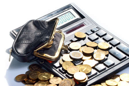 a bunch of metal rubles in a purse and a calculator Stock Photo