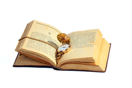 The old book and a pocket watch in a gold case and chain Stock Photo