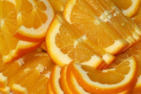 slices and pieces of sliced tropical fruit orange Stock Photo
