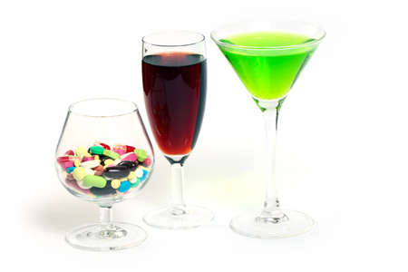wine, liquor and medical pills in glass Stock Photo