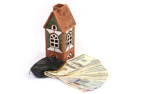 decorative house souvenir and one hundred dollar bills in your wallet Stock Photo