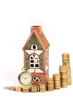 clay house, antique pocket watch and Russian gold coins as a symbol of the rental of real estate