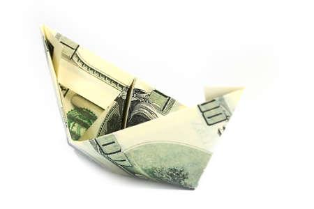 a boat built of American hundred-dollar bills, origami