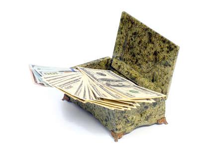 pile of paper American dollar bills in malachite casket Stock Photo
