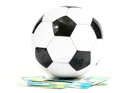 Football ball and paper Russian rubles as the national currency of the championship