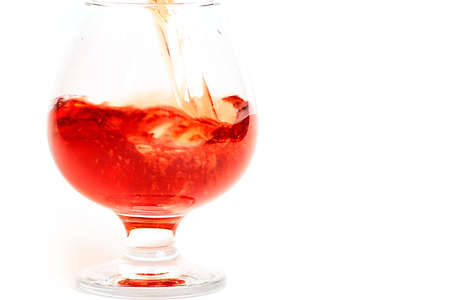 Flowing into a glass of red wine creates bizarre patterns