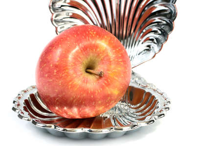 a beautiful fresh ripe apple lies in a decorative vase
