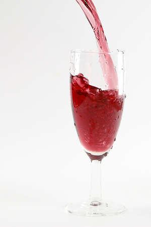 red wine creates beautiful patterns when popping into a glass