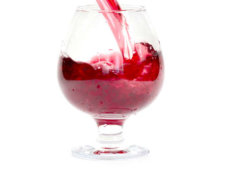 bright red wine is poured into a glass for drinking Archivio Fotografico - 100274776