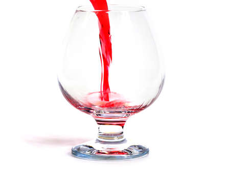 bright red wine is poured into a glass for drinking Archivio Fotografico - 100274625