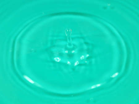 a drop of drinking water sprinkles on the surface of the liquid