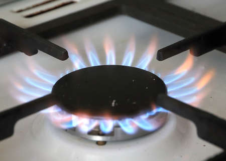 bright naked flashes of natural gas flame in the stove burner