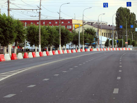 plastic road fencing on the street of a modern city