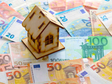 euro currency and a wooden house Banco de Imagens