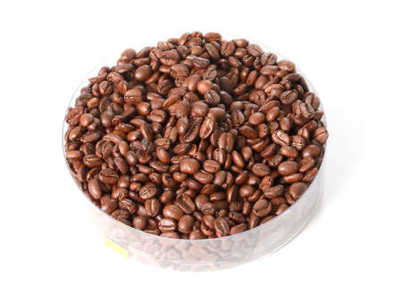 Coffee beans are in a plastic container