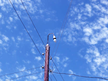 lighting lamp on a wooden pole