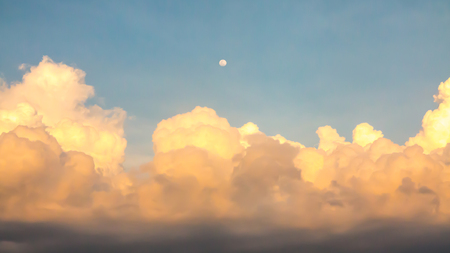 clound: A photo of moon and clounds in evening.